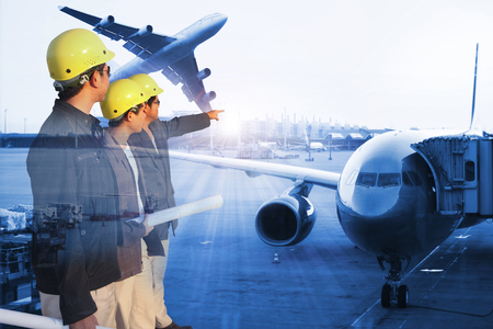 logistic: group engineer on site with Airplane at the terminal gate , Modern international airport during sunset - Concept of freight cargo plane in transport and import-export commercial logistic ,shipping business industry