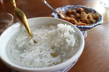 complementary: Kao-Chae (Cooked Rice Soaked in Iced Water and Eaten with the Usual Complementary Food, Chilled Rice) Stock Photo