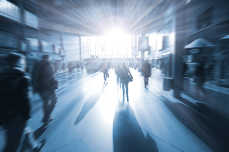 tonality: train station in the rush hour is made in the manner of blur and a blue tonality