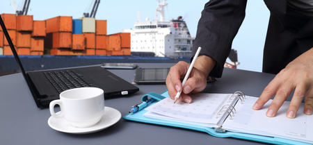 marine ship: container truck ,ship in port and freight cargo plane in transport and import-export commercial logistic ,shipping business industry ,hand of working man in shipping ,logistic freight cargo transport business Stock Photo