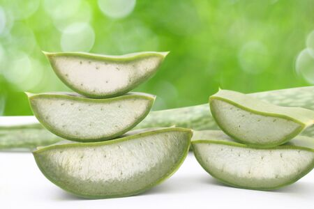 top veiw: Freshly sliced Aloe Vera showing green skin and juicy texture, on white background. Fresh Aloe Vera is natural remedy for sunburn relief and cure many things