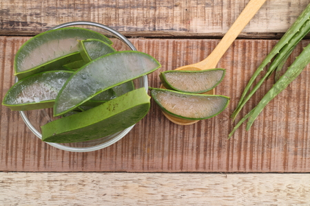 neutralize: aloe vera with aloe vera gel on wooden table. top view