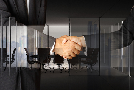 Double exposure of handshake with modern empty office interior meeting room and city background for business concept Stock Photo