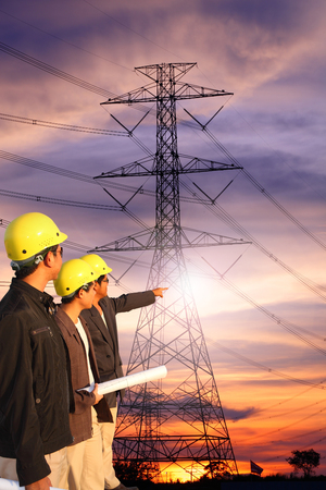 man of engineers standing at electricity station over Blurred electricity power