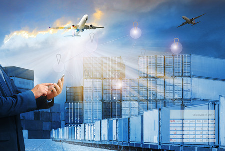 boxcar: container trains ,commercial ship on port freight cargo plane flying above use for logistic and transportation industry background Stock Photo