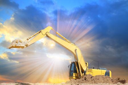 Excavators machine in construction site on sunset background
