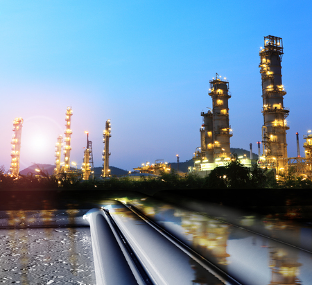 pipelines , towers,  oil and gas refinery,heavy industry : file of Tubes running in the direction of the setting sun. Pipeline transportation is most common way of transporting goods such as Oil, natural gas or water on long distances. Stock Photo