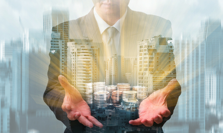 earn money: Earn money concept with businessman that holds golden coins Stock Photo