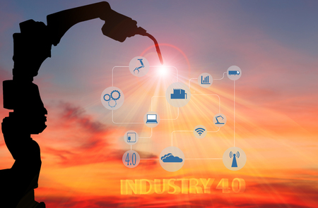 Industry4.0 concept . welding robot of automotive with wireless in smart factory background.