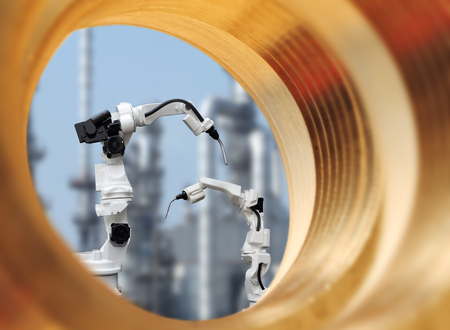 Industrial robot is welding assembly automotive part through a large cogwheels gear shaft, with large industry background Stock Photo