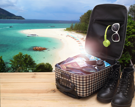 time to Travel concept,  image of  Travel Bag on Beach Background