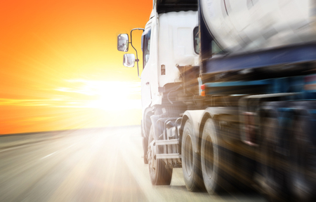 Semi Truck in Motion. Speeding on the Highway. Motion Blurred. Transportation and Spedition Photo Collection.container truck ,transport and import-export commercial logistic ,shipping business industry ,Mixed media Stock Photo