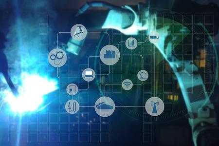 산업 4.0 개념. 자동차 산업 생산, 혼합 미디어에서 무선 로봇 팔 자동화의 산업 기호 및 블루 톤