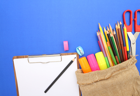 student supplies,Corner border of awide range of school supplies on a white background Stock Photo