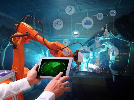 Robot welding movement for Industrial automotive part in factory,Industry4.0 concept .  Stock Photo