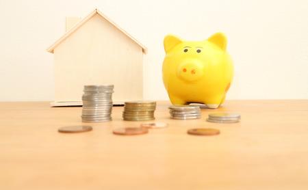 yellow piggy bank on wooden table , saving,money concept. Stock Photo