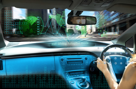self-driving autopilot mode , autonomous car, vehicle running self driving mode and a woman driver Stok Fotoğraf - 85364281
