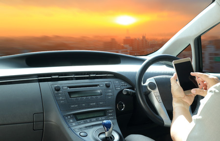 Using a smartphone while driving or use cell-phone connect to intelligent car