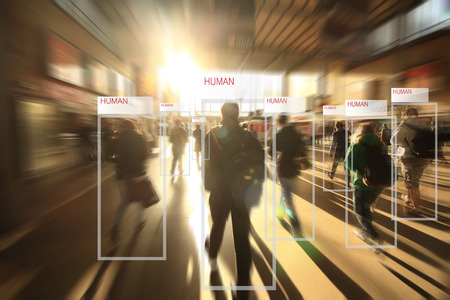 technology of machine or robot  Learning analytics identify human technology , Software  analytics and recognition people in city with flare light effect ,Artificial intelligence concept. Foto de archivo