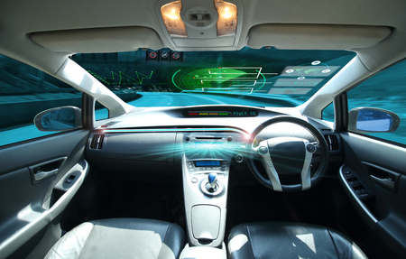 electric car or  intelligent car. connected car. Internet of Things. Heads up display(HUD).futuristic vehicle and graphical user interface(GUI).self-driving  mode ,  vehicle running self driving mode and a woman driver