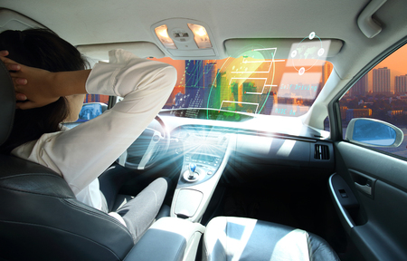 electric car or  intelligent car. connected car. Internet of Things. Heads up display(HUD).futuristic vehicle and graphical user interface(GUI).self-driving  mode , autonomous car, vehicle running self driving mode and a woman driver  Banco de Imagens