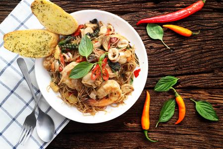 spaghetti seafood on wood table  Фото со стока