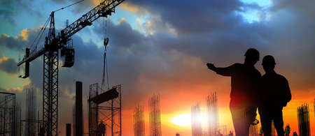 two engineer on working site , engineer and tower cranes at construction site and city background 免版税图像 - 93810290