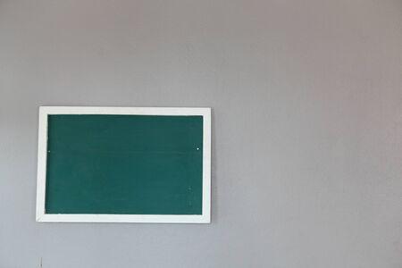 Green chalkboard on wall