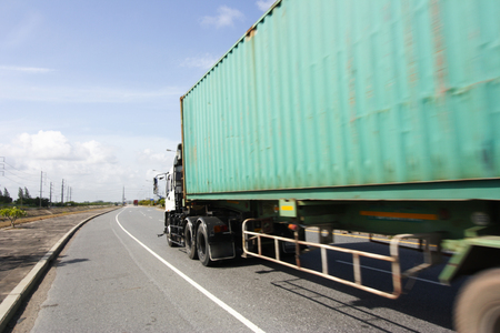 Transportation concept,import,export logistic industrial,Truck on highway road with big container Stock Photo