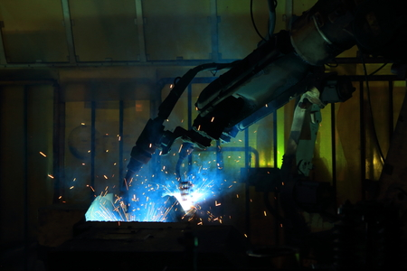 welding robot are working in automotive industry
