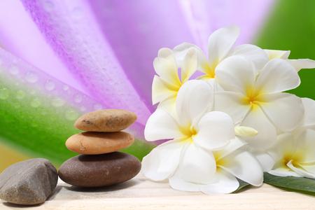 Zen spa concept background - Zen massage stones with frangipani plumeria flower