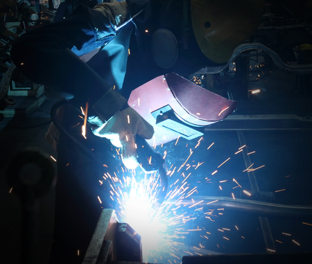 man worker is welding