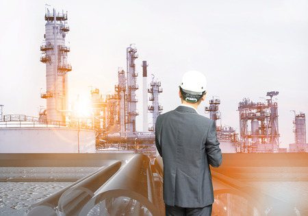 man and oil and chemical refinery