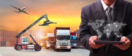 Multiple exposures of Businessman touching tablet for analyze at logistics port , there are world map with logistic network distribution on background and Logistics Industrial Container Cargo freight ship for Concept of fast or instant shipping Imagens - 120426815