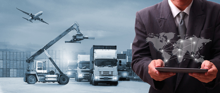 Multiple exposures of Businessman touching tablet for analyze at logistics port , there are world map with logistic network distribution on background and Logistics Industrial Container Cargo freight ship for Concept of fast or instant shipping