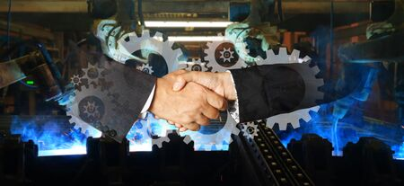 hand shaking and Team welding robots represent the movement. In the automotive parts industry.