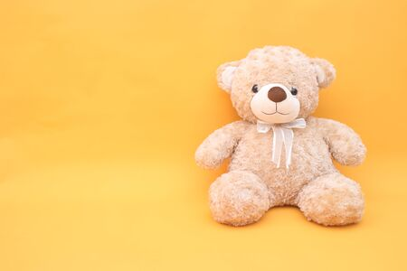 Teddy bear on yellow background Stock Photo