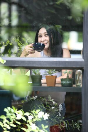 woman relax at coffee shop