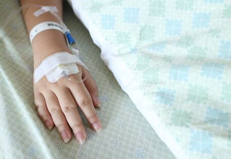 Focus on woman hand of a patient in hospital Stock Photo
