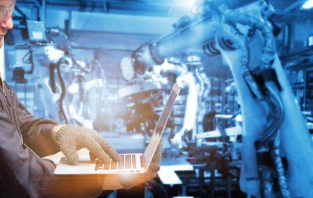Double exposure of hand man with group welding robots are working In the automotive parts industry.