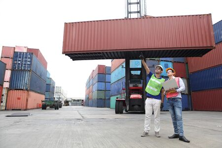 Engineering team working and they are loading container for support logistics and import export business