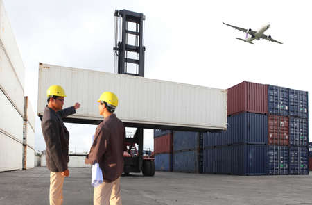 Engineering group working and they are loading container for support logistics and import export business 版權商用圖片