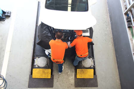 car mechanic use notebook computers to check engine and service maintenance of industrial to engine repair, for transport automobile automotive , top view image 版權商用圖片