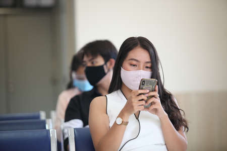 Covid-19 concept. People wearing mask for protect cough with Covid-19 virus outbreak , work from home , new normal 版權商用圖片