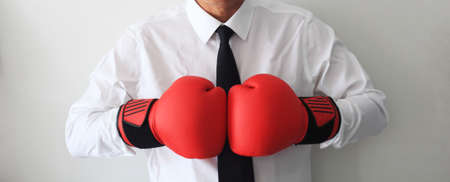 Business man ready to fight with boxing gloves
