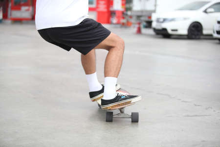 Close-up leg on surf skate or skateboard , Sport activity lifestyle concept, Healthy and exercise