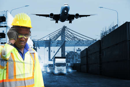 Close up of An African American handsome black engineer he is working in container box yard area,The world logistics  background or transportation Industry or shipping business, Container Cargo  shipment , truck delivery, airplane , import export Concept