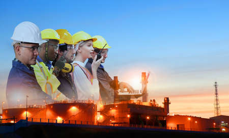 team and oil refinery, Teams engineer and foreman working at petrochemical oil refinery in sunset
