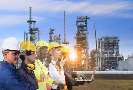 Pipeline transportation is most common way of transporting goods such as Oil, natural gas or water on long distances with oil refinery industry plant background and Engineer on site, they are working at building construction area.