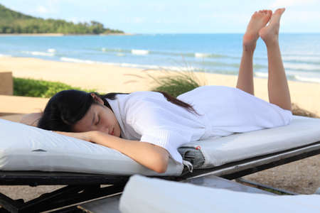 Summer day lifestyle woman relax  at the beach resort outdoors the hotel. Vacations and Summer Concept